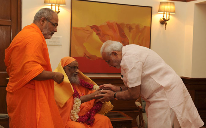 The Founder of Arsha Vidya Gurukulam, Swami Dayananda Saraswati calls on the Prime Minister, Shri Narendra Modi, in New Delhi on August 18, 2014.
